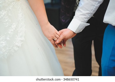 couple holding hands at wedding