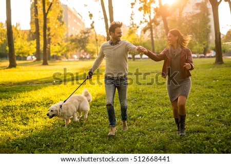 3dcd7ebf Couple Holding Hands While Walking Dog Stock Photo (Edit Now ...