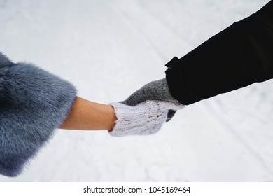 Couple holding hands in winter