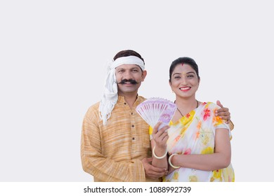 couple holding indian currency