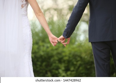 Couple holding their hands on wedding day. Couple in love
