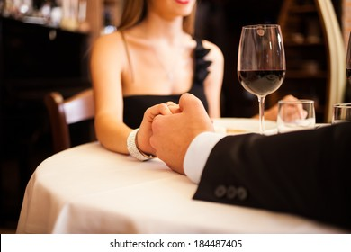 Couple holding their hands in a restaurant