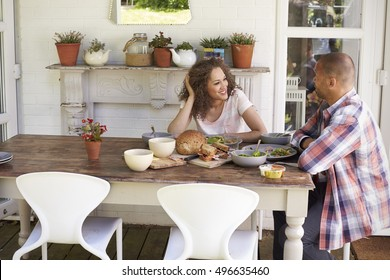 Couple At Home Eating Outdoor Meal Together