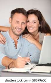 Couple at home surfing on internet