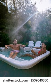 couple in hot tub bath in the rain forest of  Vancouver Island