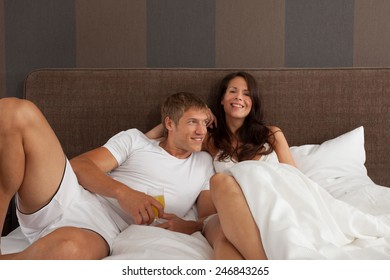 couple in hotel bed