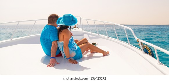 Couple in hug relaxing on the luxury yacht cruise