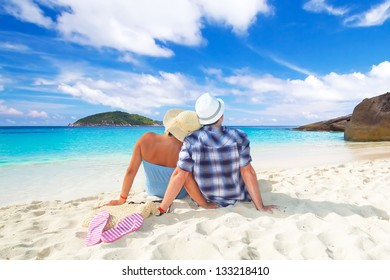Couple in hug sitting together at the Caribbean Sea