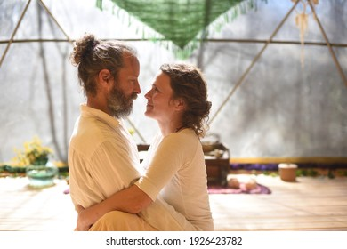 Couple hugging and looking at each other in tantra yoga