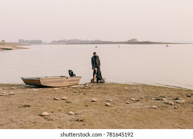 Couple hugging near the water
