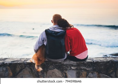 Couple hugging on background beach ocean sunrise, silhouette two romantic people cuddling and looking on rear view evening seascape, hipster with dog enjoy sunset together, travel holidays vacation