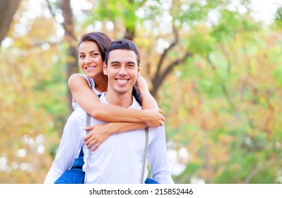Couple hugging in the park.