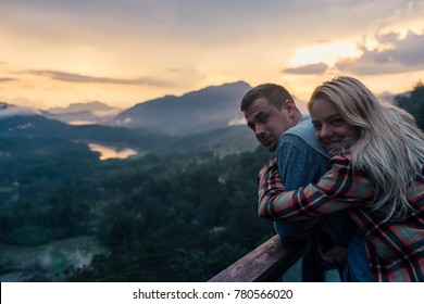 Couple hugging at sunset in the mountains close-up portrait