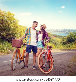 Couple hugs on road, vintage bike, romantic travel