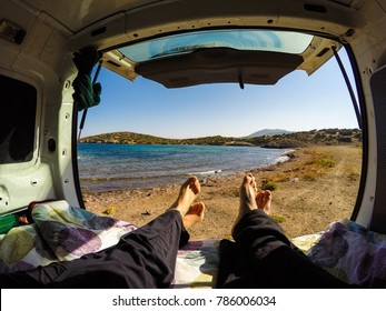 Couple inside a campervan and nice landscape outside