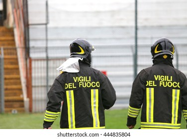 couple Italian firefighters with uniform with the written FIREFIGHTERS do the security service in the Stadium during the sporting event