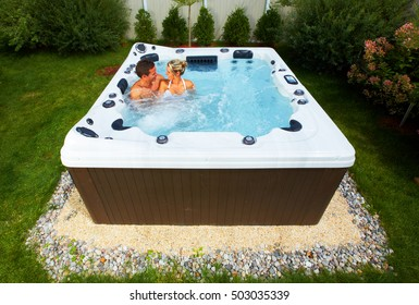 Couple in jacuzzi.