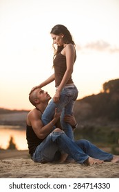 Couple in jeans on a sunset