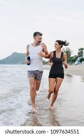 Couple jogging on a beach