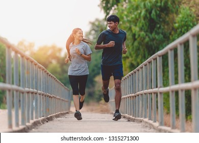 Couple jogging and running , Fitness couple stretching outdoors, Young man and woman exercising together.