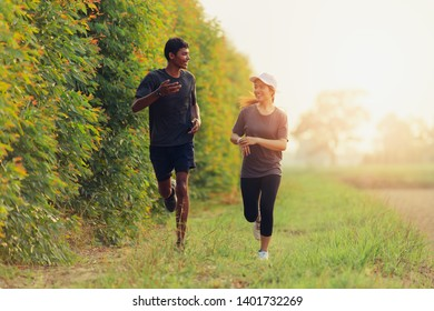 Couple jogging and running, Young man and woman exercising together.