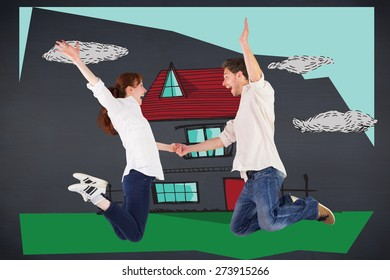 Couple jumping and holding hands against black background