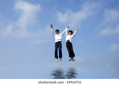 Couple jumping with reflection