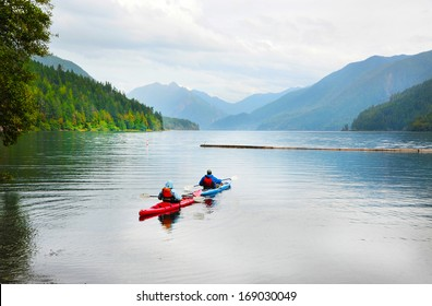 A couple kayaking on Crescent Lake in Olympic Park, USA