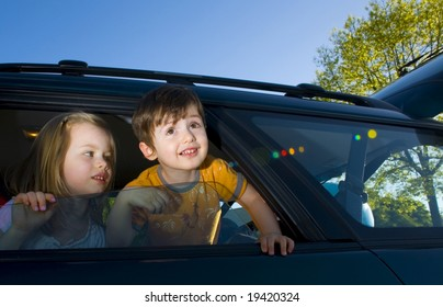 couple kids look through the car window