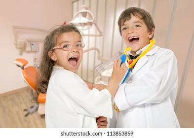 A couple of kids playing doctor at the dentist
