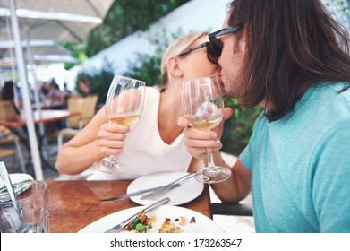 Couple kiss and celebrate engagement at lunch