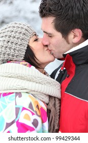 Couple kissing during winter holiday
