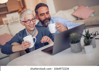 Couple with laptop.Senior couple working with laptop at home.