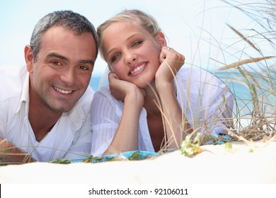 Couple laying on a beach
