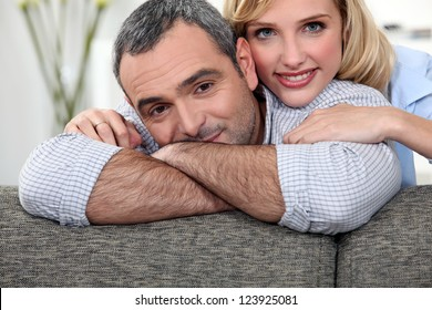 couple leaning on a sofa