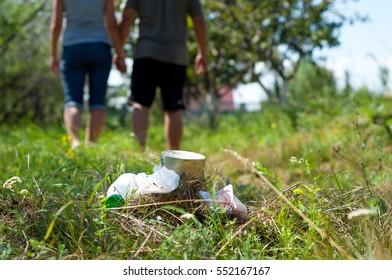 Couple left trash in park. Walking away.