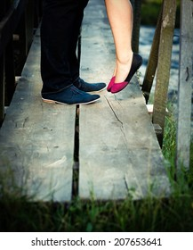 Couple legs kissing - vintage photo