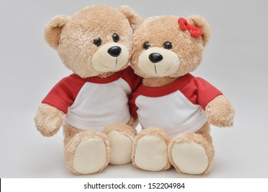 Couple of light brown teddy bear on white background
