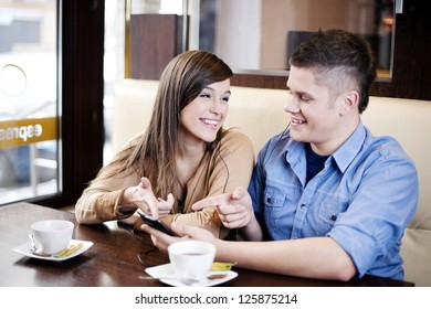 Couple listening music in cafe