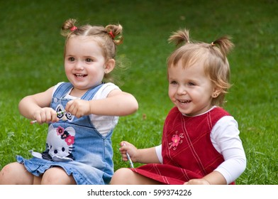 couple of little girls spending time outdoors. friendship