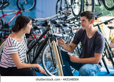 Couple looking for bicycle in bike shop
