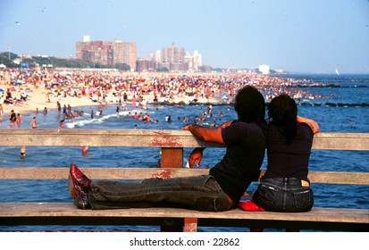 Couple looking at Coney Island.