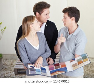 Couple looking at different carpet samples at floorlayer