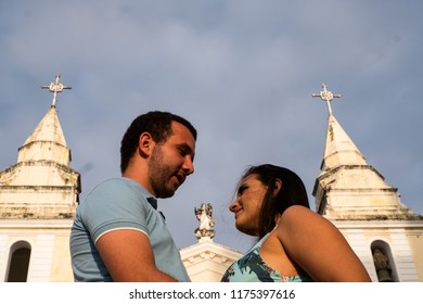Couple looking into the eyes in frot of the church Built by Jesuits, the Sé Cathedral, in São Luis do Maranhao, is a tribute to Our Lady of Victory
