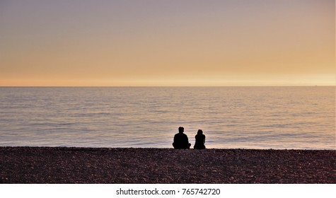 Couple looking at the Mediterranean Sea,peace, lover, romanticism,calm, serenity, harmony, fullness, well-being, nature, natural, contemplate, spring, breathe, grow, happiness, tranquility,