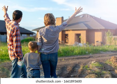 couple looking on new house