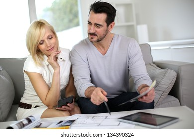 Couple looking at paint colors for new home