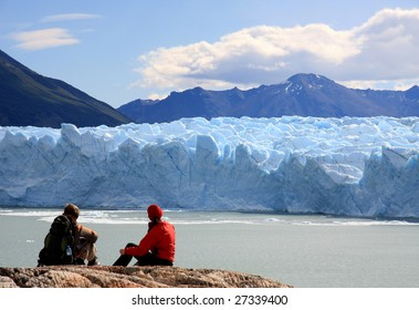 Couple looking at Perito Moreno Glacier, Patagonia, Argentina
