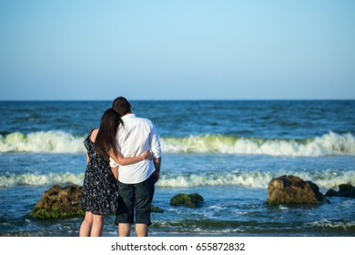 Couple looking at the sea