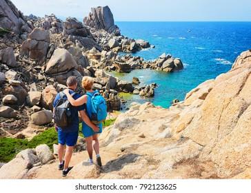 Couple looking at the Sea and rocks in Capo Testa, Santa Teresa Gallura, Sardinia, Italy